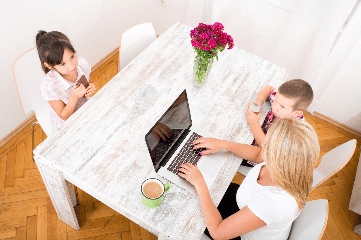 picture of mom working from home with her kids