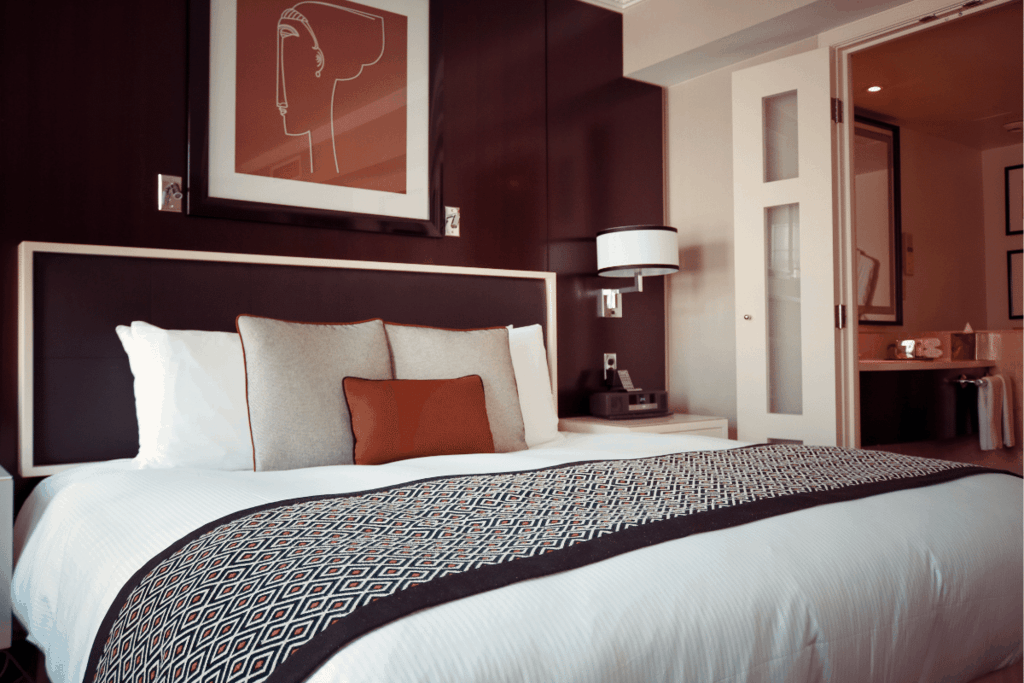 Picture of a hotel bed save money by booking through hotwire