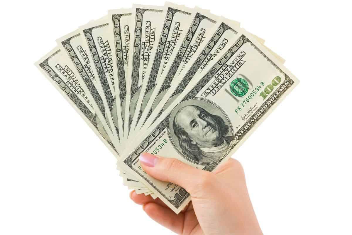 woman holding handful of money