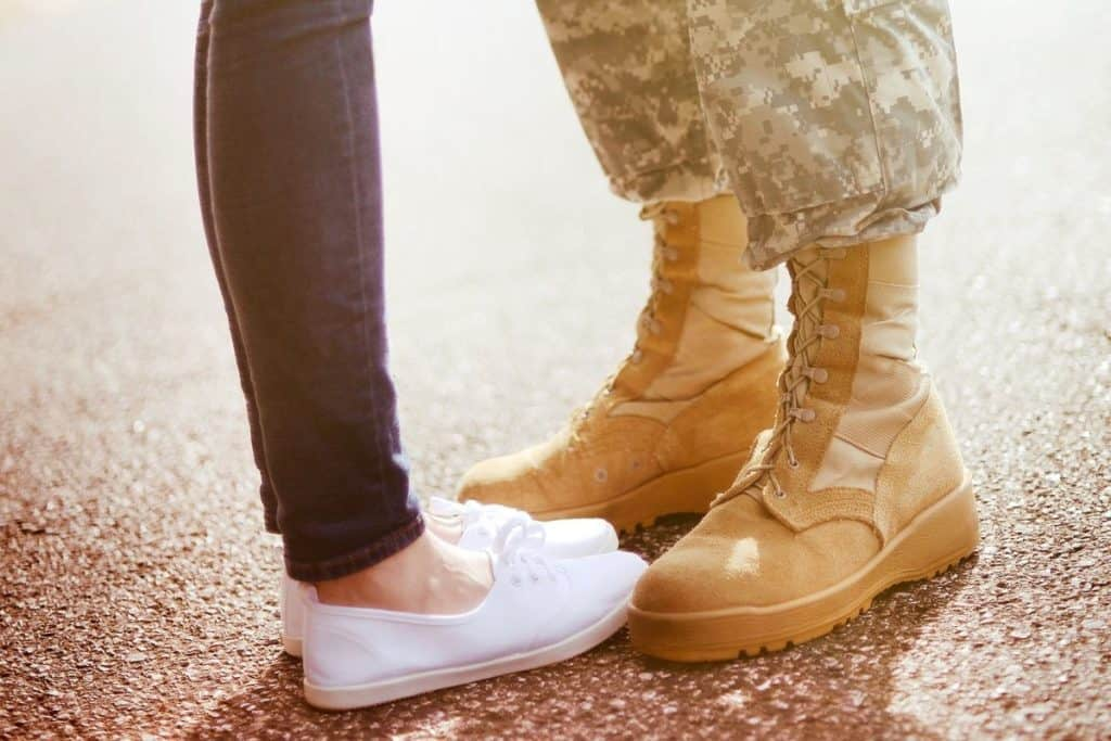army wife standing with husband
