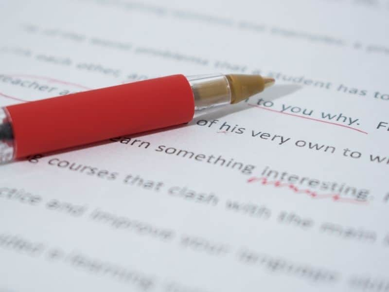 red pen on a piece of text covered paper