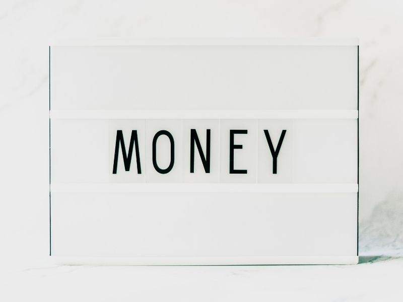"""white background with the word """"money"""" across it"""