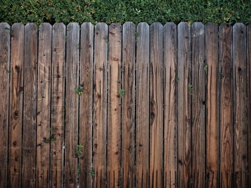 a brown wooden fence