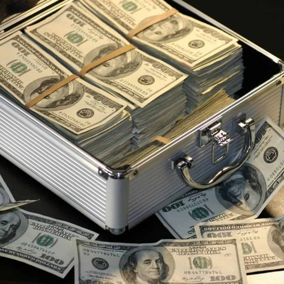 a white box of money with bills spilling out