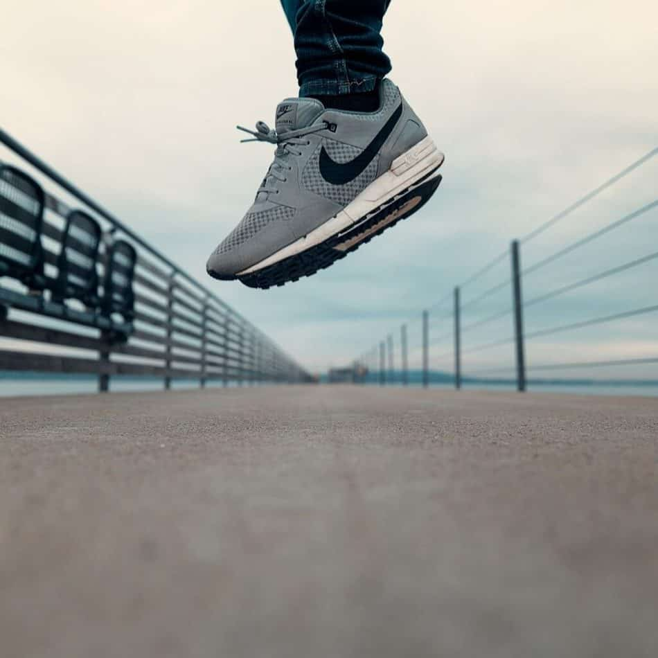 a person in nike sneakers jumping