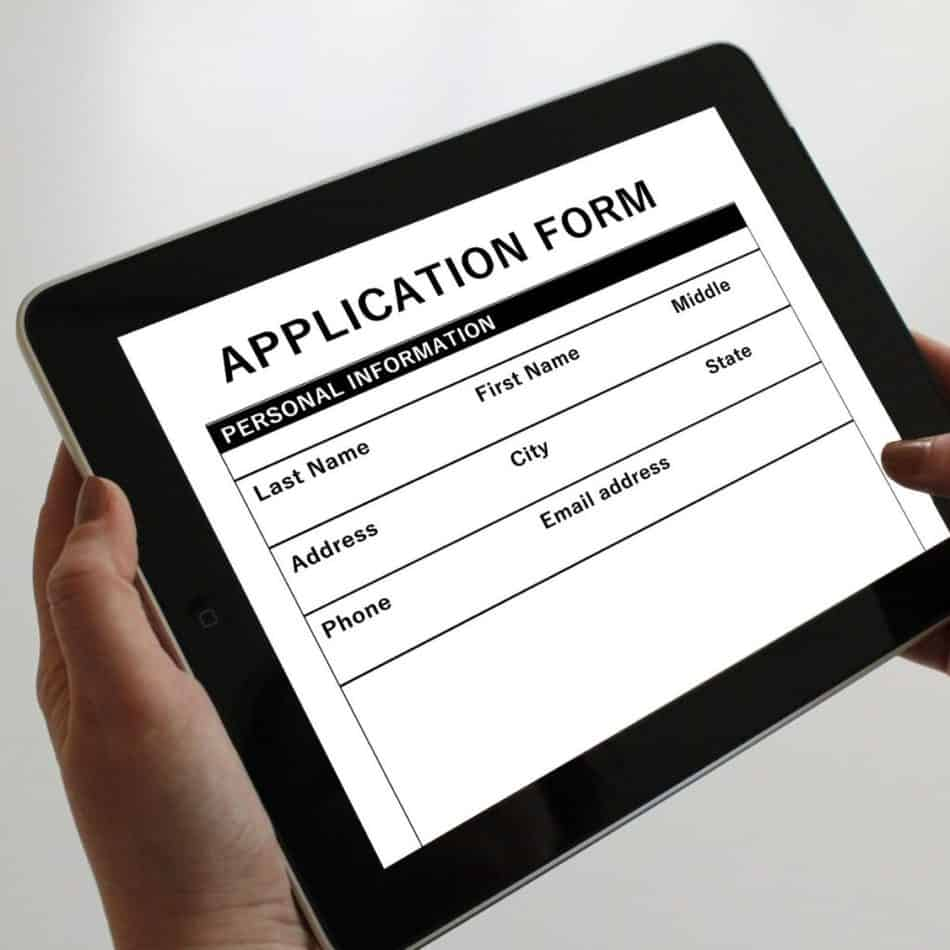 a tabley with an application form on the screen