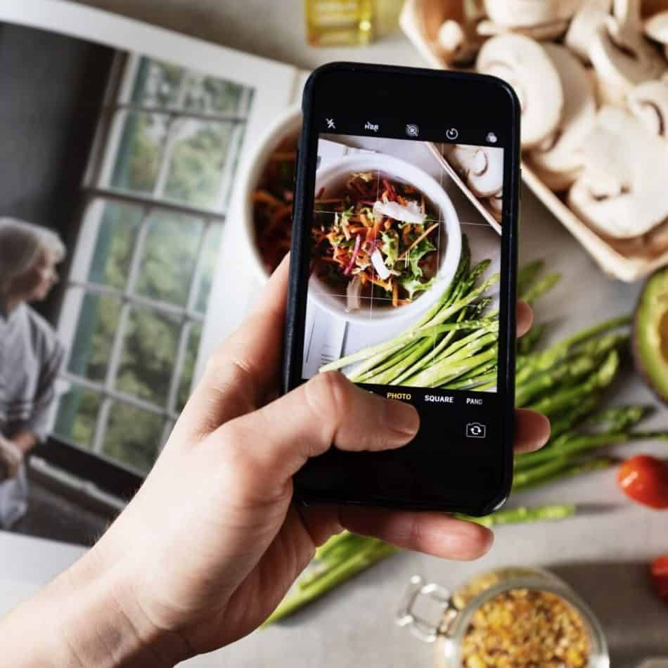 a smartphone taking a picture of food